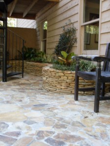 Court yard-stone floor and stone planters by Jonathan