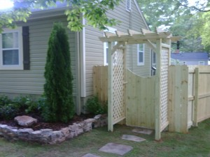 Arbor with wooden fence and gate