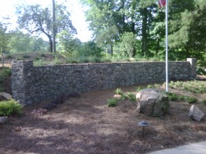 Moss Rock Wall with Flag Pole